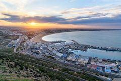 Beach in Agadir city at sunrise, Morocco. View of long, wide beach in Agadir city at sunrise, Morocco Stock Photo