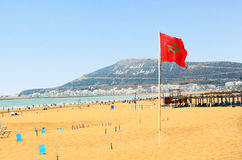 Beach in Agadir with flag of Morocco. The beautiful beach in Agadir with flag of Morocco Royalty Free Stock Image