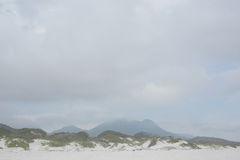 Beach against the misty mountains Royalty Free Stock Image
