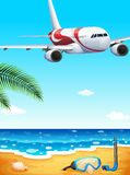 A beach with an airplane uphigh Royalty Free Stock Images