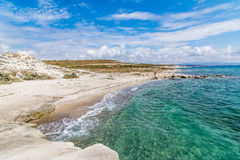 A beach in Alacati. Alacati is populer holiday destination. It has olsa a lot of natural white sand beaches Stock Photography