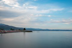 The beach of Albenga on sunset Stock Images