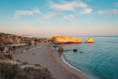 Beach in Algarve coast, summertime in Portugal. Sunset Stock Photography