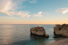Beach in Algarve coast, summertime in Portugal. Sunset Royalty Free Stock Image
