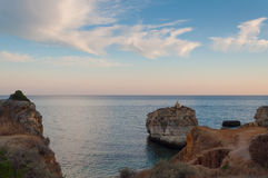Beach in Algarve coast, summertime in Portugal. Sunset Royalty Free Stock Photos
