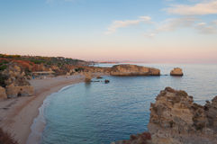 Beach in Algarve coast, summertime in Portugal. Sunset Royalty Free Stock Images