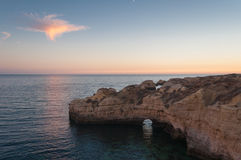 Beach in Algarve coast, summertime in Portugal. Sunset Royalty Free Stock Photo