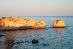 Beach in Algarve coast, summertime in Portugal Stock Photos