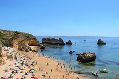 Beach in Algarve, Portugal. A beautiful sunny beach in Algarve, Portugal. One of the most loved seaside resorts in Europe Stock Photography