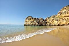 The beach in the Algarve in Portugal. The beach near Alvor in the Algarve in Portugal Stock Photos