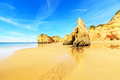Beach in Algarve region, Portugal. A view of a Praia da Rocha in Portimao, Algarve region, Portugal Royalty Free Stock Images