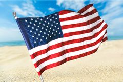 Beach American Flag. Flag American Culture USA Waving The Americas Stock Photo
