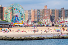 The beach and the amusement park at Coney Island in New York City. NEW YORK,USA - AUGUST 18,2016 : The beach and the amusement park at Coney Island in New York stock image