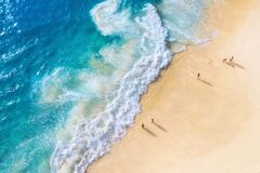Free Beach And Large Ocean Waves. Coast As A Background From Top View. Blue Water Background From Drone. Summer Seascape From Air. Royalty Free Stock Photo - 201537405
