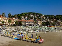 Beach with parasols in Andora stock photos