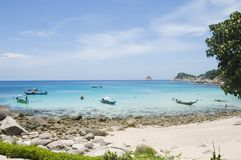 Beach of Ao Leuk, in Koh Tao. Beach of Ao Leuk : long-tail boats, swimmers, snorkelling  in Koh Tao, Thailand Royalty Free Stock Image