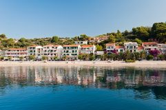 Beach with apartments in Podgora-Caklje, Croatia. Amazing beach with apartments and palm trees in Makarska Riviera in Podgora-Caklje, Croatia Stock Images