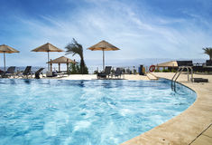 Beach in Aqaba, Jordan. Swimming pool near the beach. Red sea, Aqaba, Jordan Stock Image