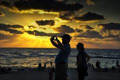Taking photo of Caesarea in sunset. The beach of the Aquaeductus at Caesarea in sunset Israel Stock Photo