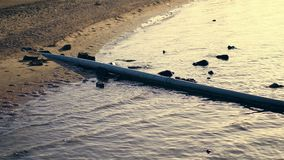 From the beach area to the sea, a sewer pipe is being displayed. hotel complex brought its sewage into the sea