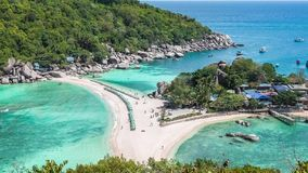 Beach with arriving tourist and sunbed on Koh Nangyuan Island on bright sunny day surraunded by beautiful crystal clear. Blue water, Surat Thani, Thailand stock footage