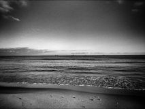 On the beach. Artistic look in black and white. Stock Images