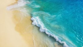 Beach as a background from top view. Waves and azure water as a background. Summer seascape from air. Bali island, Indonesia. stock photography