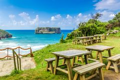 Beach of Asturias. Views of an islet from a picnic table in Asturias, Spain Stock Image