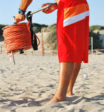 Beach-attendant. Beach attendant working on the sand Royalty Free Stock Image