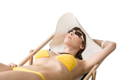 Beach - Attractive woman in bikini relaxing Royalty Free Stock Image