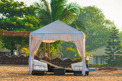 Beach awning with sun loungers Royalty Free Stock Photography