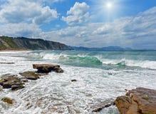 Beach Azkorri or Gorrondatxe sunshiny view. Sunshiny Beach Azkorri or Gorrondatxe in Getxo town, Biscay, Spain Stock Photo