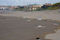 Beach in Azores. People have left all kind of waste to otherwise nice beach. Azores, Portugal stock images
