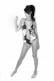 Beach babe. Female model wearing a swimming costume.  This is edited to black and white to make her seem as though she is standing agaist or on nothig Stock Images