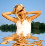 Beach babe in water Stock Images
