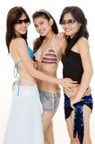 Beach Babes #10. Three cute asian women in beach wear royalty free stock photography