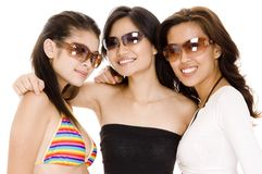 Beach Babes #20. Three attracive asian women in sunglasses royalty free stock image