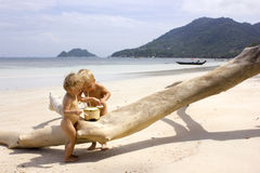 Beach babies with coconut Royalty Free Stock Photography