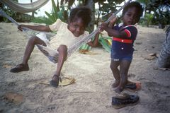 Beach babies in Negril, Jamaica Stock Images