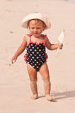 Beach Baby. Little girl walking in the sand Royalty Free Stock Photos