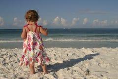Beach baby. A little girl on the beach Stock Photos