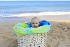 Beach baby in the basket Royalty Free Stock Photo