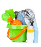 Beach baby toys, towel and bottles Stock Image