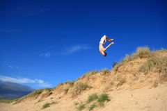 Beach Backflip Stock Photo