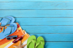 Beach background, copy space, flip flops, sunglasses Stock Photography