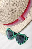 Beach Background with Hat and Sunglasses Royalty Free Stock Photography