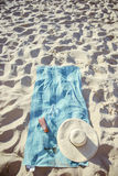 Beach background with hat and towel Stock Image