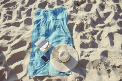Beach background with hat and towel Royalty Free Stock Photo