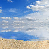 Beach background with a heap of sand on a background of sky Royalty Free Stock Image