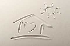 Beach background with home. And heart drawing royalty free stock photos